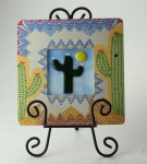 Saguaro in Bloom, fused glass by Diane C. Taylor, in hand-painted frame by Patty Lyons
